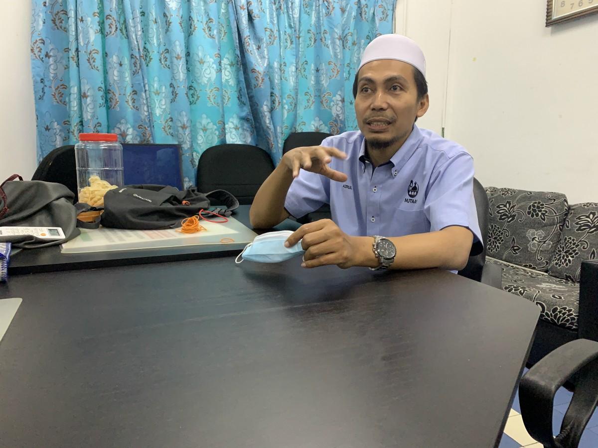 Azrul Azli bin Abdul Aziz Khatib, an imam at Masjid Jamek Tengku Abdul Aziz Shah, which serves the urban village of Kampung Penchala just outside Kuala Lumpur.